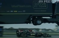 A truck jumps over a F1 racing car