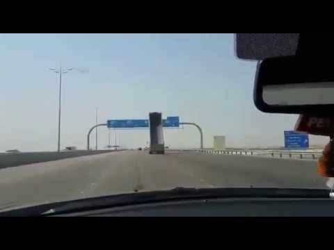 Watch this clueless truck driver ram into a highway sign.