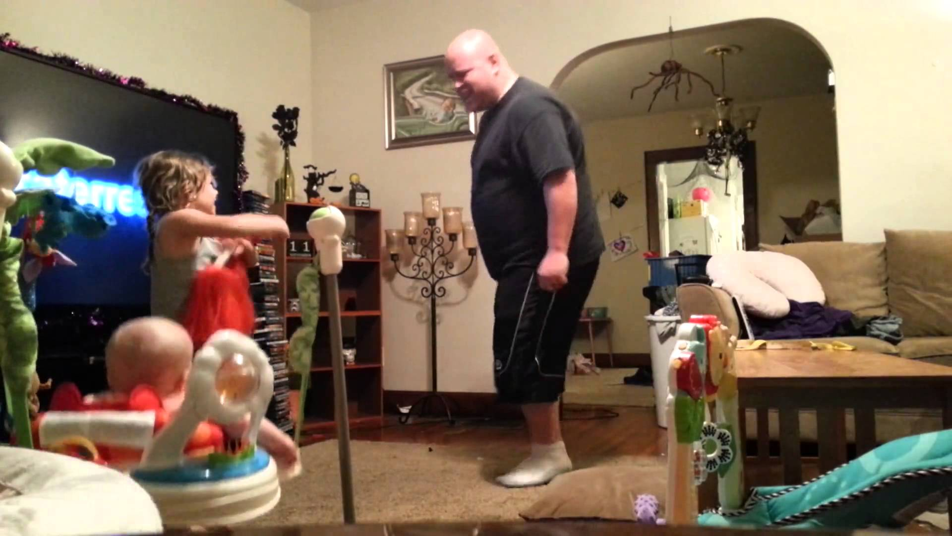 Husband caught on hidden camera playing with the kids