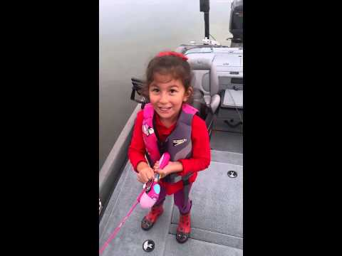 Little girl catches a huge sea bass