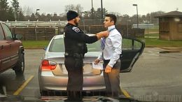 Police officer helps student tie his tie
